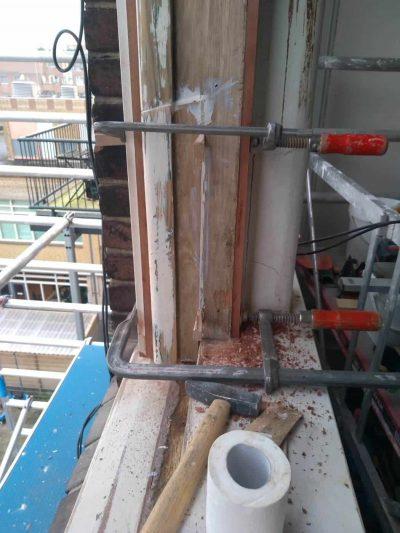 Houten kozijnreparatie houtrotherstel VVE Den Haag